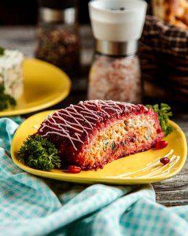 dressed-herring-salad-potato-carrot-beetroot-onion-mayonnaise-side-view.jpg